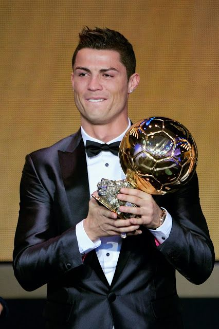 Real Madrid's Portuguese forward Cristiano Ronaldo poses with the 2013 FIFA Ballon d'Or award for player of the year during the FIFA Ballon d'Or award ceremony at the Kongresshaus in Zurich.