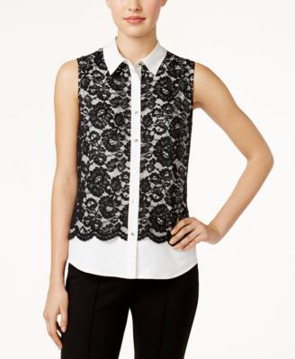 Calvin Klein's layered-look lace top lends feminine flair to your workday ensemble. | Polyester/spandex | Dry clean | Imported | Point collar  | Front button closures | Layered look lace shell overlay