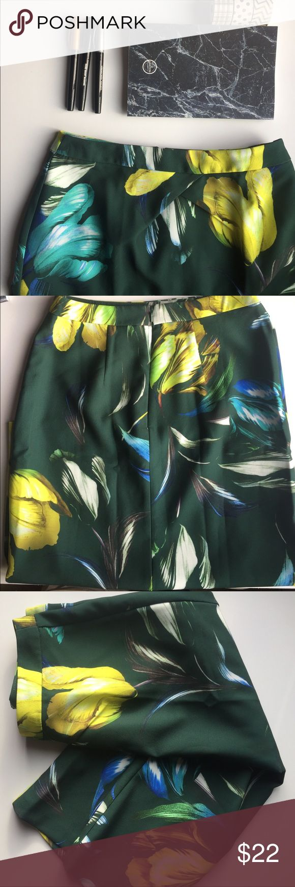ASOS Petite Floral skirt size 4 This is a midi length skirt - 26.5 inches long. It has two small, and very unnoticeable flaws that I did take a photo of and you can see. It is a petite skirt, size four. The colors all pop out, and it is a gorgeous piece to add to your wardrobe. ASOS Petite Skirts Midi