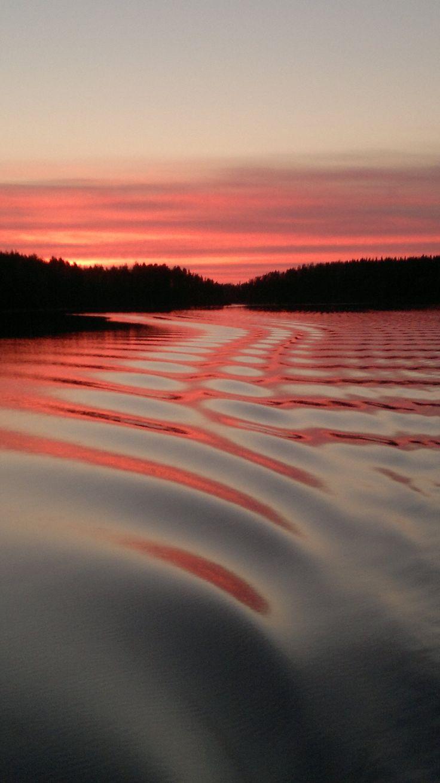 Saimaa kevätiltana veneestä. Lake Saimaa, photo taken from the boat, Finland