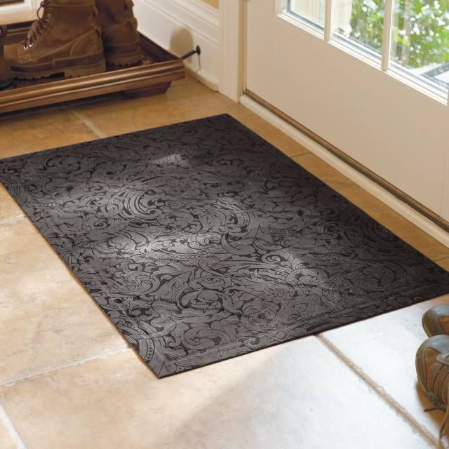 Crafted from durable microfiber, the Scroll Trellis Low-profile Mat enhances your doorway while protecting floors from damage. The elegant design is slightly raised to remove dirt and debris from shoes while still retaining an overall low profile that won't obstruct doors.Durable 100% polyester microfiber constructionLow-profile design won't obstruct doorsMade of 20% recycled contentHeavy-duty rubber backing prevents skiddingSafe for use on hardwood floorsSpray with a hose and air dry...
