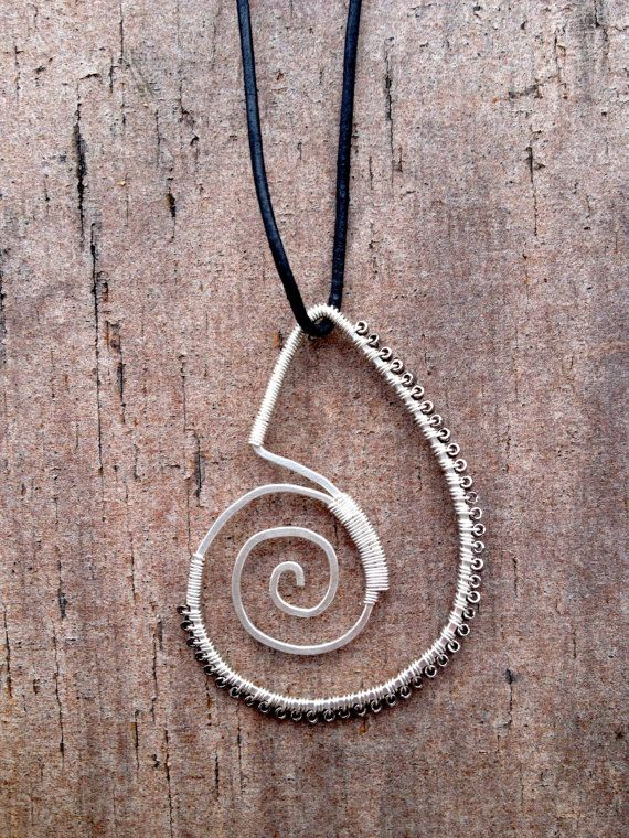 This delicate pendant made in silver wire and glas beads, has the form of the spiral of life.<br><br>Dimensions: 5.5 x 3.5 cm<br><br><>/<>/<>/<>/<><br><br>The spiral symbolizes the process of growth and evolution. Represents the process to return to the same point again and again, ...