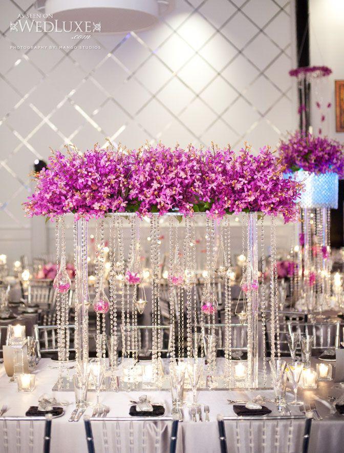 suspended floral arrangement with purple flowers and. Black Bedroom Furniture Sets. Home Design Ideas