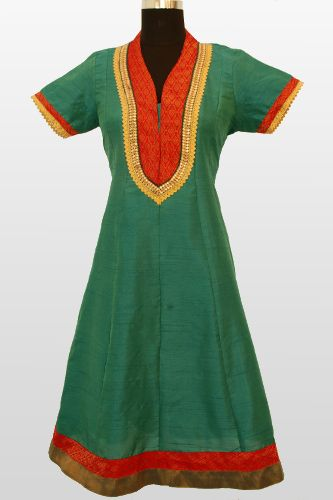 Look perfect at your workplace with this bottle green formal kurti in silk.