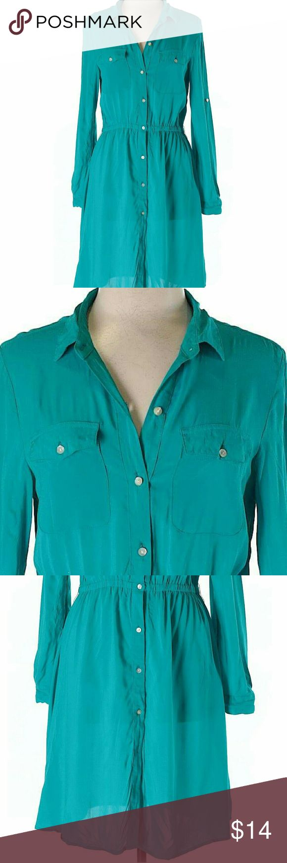 "Teal Shirt Style Dress Soft Rayon solid teal blue dress with buttons in the front all the way down. Elastic waist with long button cuffed sleeves. Two front Bossom PO keys and a V neck finish this casual and stylish look. 34"" chest and 38"" lenght. Brooke Leigh Dresses Long Sleeve"