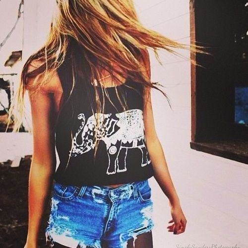 Elephant shirt and ripped cut-off shorts.