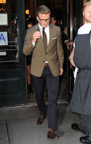 David Beckham wearing Ralph Lauren Blazers and Saint Laurent Boots.
