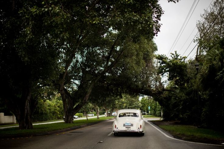 Stunning Coral Gables Wedding at The Biltmore Hotel, FL  Fun antique car exit from a wedding!   Photographer: Quetzal Wedding Photo