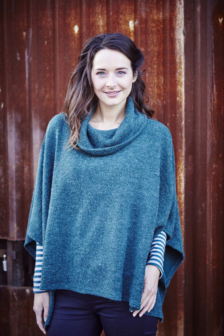 Bluey green, loose fitting turtle neck poncho by Lily & Me. Perfect to dress up a casual autumn/winter outfit.