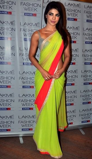 Priyanka Chopra in a Manish Malhotra Neon Saree. Online Saree Shopping - http://www.kangabulletin.com/online-shopping-in-australia/bollywood-fashion-australia-discover-a-striking-collection-of-indian-clothes/ #bollywood #fashion #australia #sale buy sarees online and salwar kameez online