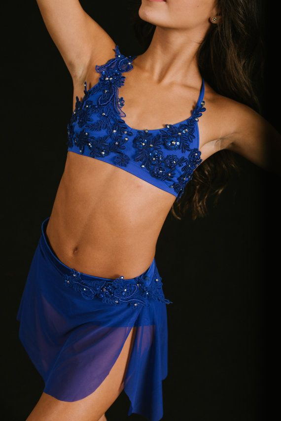 Sapphire blue appliquéd top with a mesh skirt with satin elastic and a separate matching brief. The top is rhinestoned in Swarovski Crystal AB Xirius 30 mm stones. Brief included . Can be ordered in sapphire blue, red , pink , lilac or white in any size Can be ordered without stones for $280.00 lyrical dance costume, Navy lyrical contemporary costume,ready to ship lyrical dance costume,