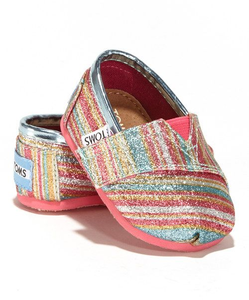 It's as easy to slip this sparkling shoe on little feet as it is to make a big difference. TOMS' classic styling with its toe-stitch and elastic V goring gets kid-size perks like a flexible rubber cupsole and adjustable strap for the perfect, snug fit. An