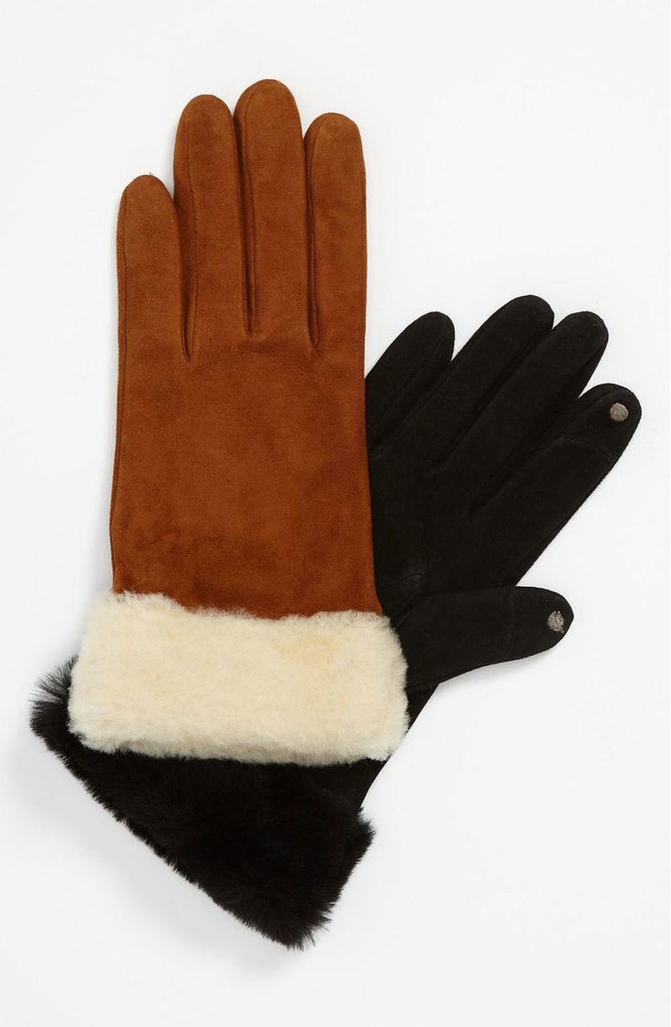 Cozy genuine shearling sheepskin gloves lined with a kiss of cashmere feature inconspicuous grippers at the thumbs and index fingers that allow for easy manipulation of touchscreen devices.