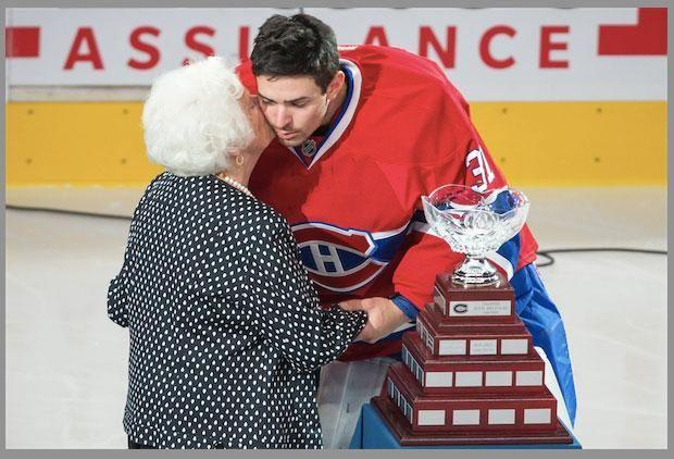 Wonderful @darioayalaphoto photo of Élise Béliveau wishing #Habs @CP0031 well as he accepts Jean Béliveau Trophy - fromDave Stubbs