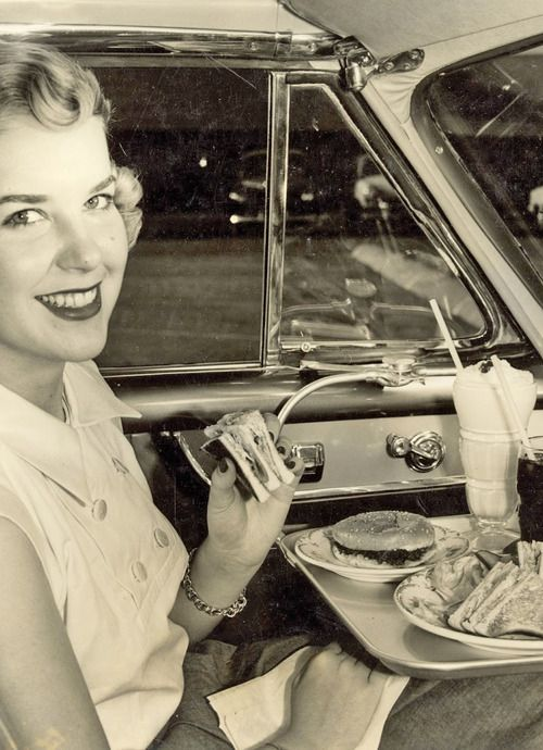 Dinner at the drive-in movie theater, 1952... where a tray with room to spare fit in, in the driver's seat.