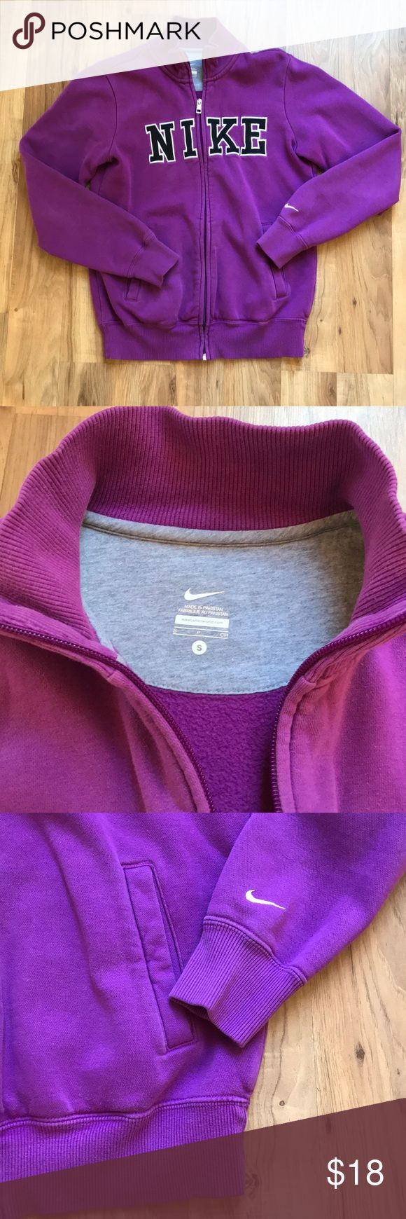 Nike Womens Purple Zip Up Sweatshirt Super soft purple Nike Zip Up front with pockets. Embroidered Nike logo at chest. Some general fading but no stains or tears. Comfy for 🏋️♀️ working out! 💪 Nike Tops Sweatshirts & Hoodies