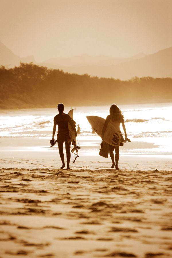 Surfer girls at Byron Bay, Australia