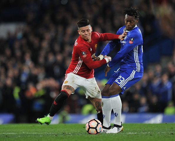 Chelsea's Michy Batshuayi battles for possession with Manchester United's Marcos Rojo during the Emirates FA Cup QuarterFinal match between Chelsea...