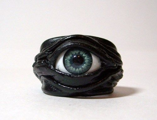 Unique adjustable leather ring.  Devil eyes leather ring. Base is made of light…