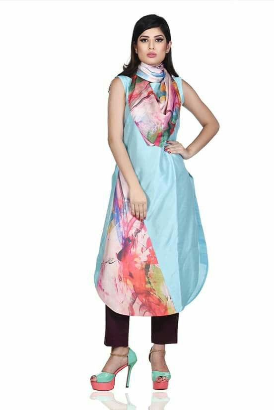 Light blue kurti and dark brown trousers with abstract printed scarf.