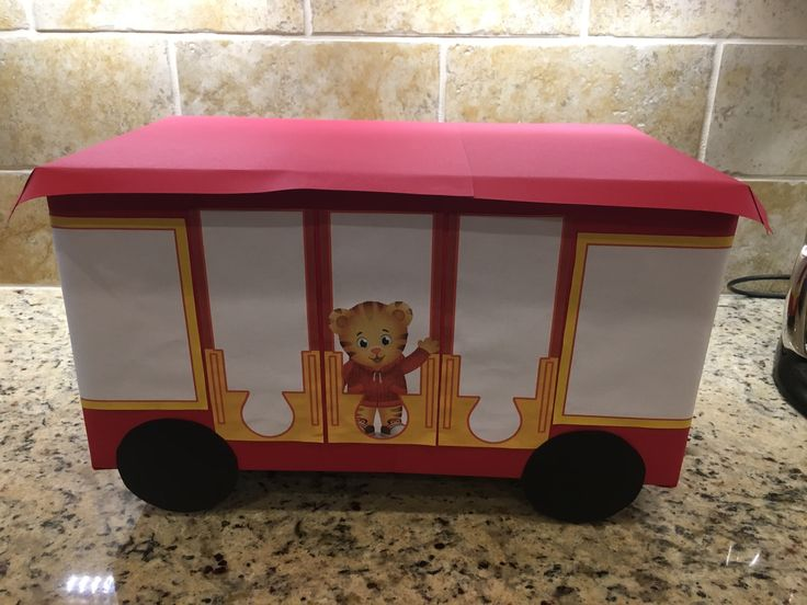 Ideas for how to build a cake stand to look like Trolley for a Daniel Tiger themed birthday party.