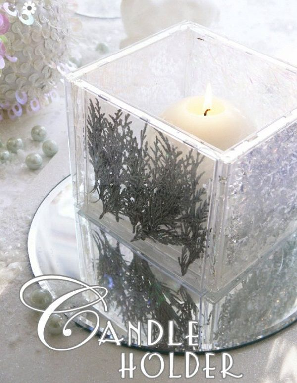 DIY Candle Holder made with clear cd cases and hot glue,you could put anything in the case.