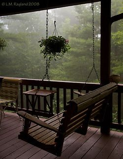 Imagine waking up in a cozy cabin in the mountains and walking out onto this porch with coffee in hand, inhaling the fresh smell of an early morning's rain:) Peaceful.