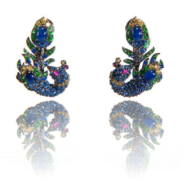 These stunning earrings are inspired by the natural beauty of peacock glory feathers. Crafted in 18K gold and set with color intensive rubies, blue, pink and yellow sapphires and green garnets. These earrings are easy to wear and makes your look unique. Perfect for day wear as well as for a night out.