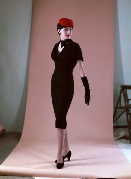 Model in slim-fitting cocktail dress by Christian Dior, 1950.1950s fashion