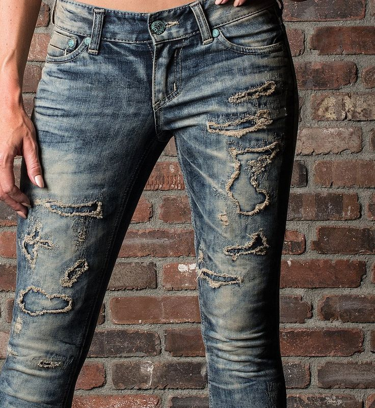 DETAILS • Affliction Women's Denim • Skinny Fit • Indigo Denim With 3D Resin Whiskers • Cut Out Destructed Front Leg Detail With Self Fabric Repair • Slim Thigh • Low Rise CONTENT AND CARE • 98% Cotto