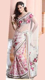 White color georgette and net joint half and half saree is with embroidered and printed motifs ,crochet work along with 9-yard patchwork borders.