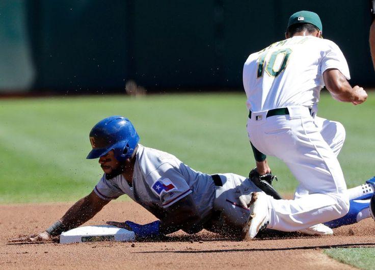 Delino DeShields steals second in the first inning Saturday, Sept. 24, 2016, in Oakland. (AP Photo/Marcio Jose Sanchez)
