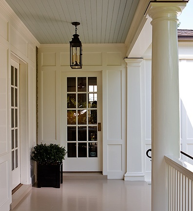 Neutral Paint on Porch floor, sky blue on the ceiling, and real candles in the lighting fixtures!