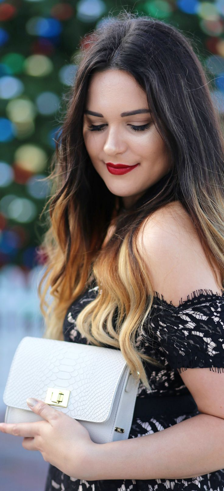 The most gorgeous clutch and off the shoulder lace dress combination! | Fashion blogger Mash Elle shares the perfect outfit for New Years Eve!