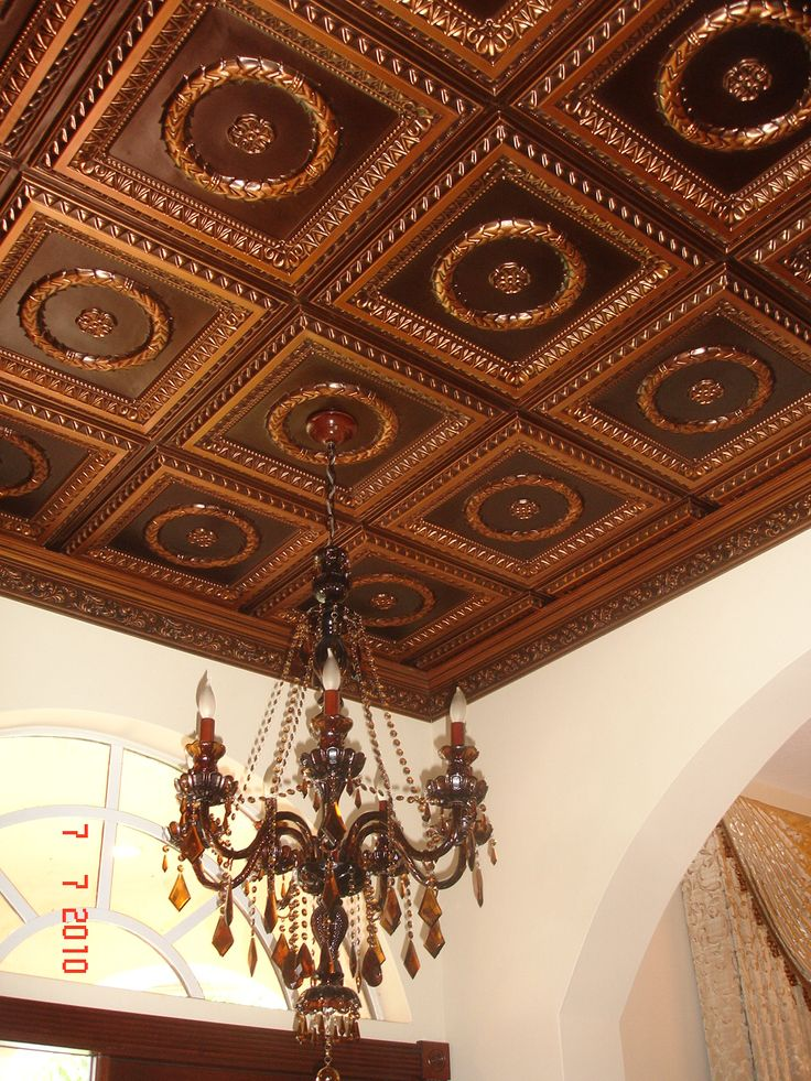 210 antique copper faux tin glue up ceiling tiles installed on a 12 foot ceiling with a dark glass chandelier
