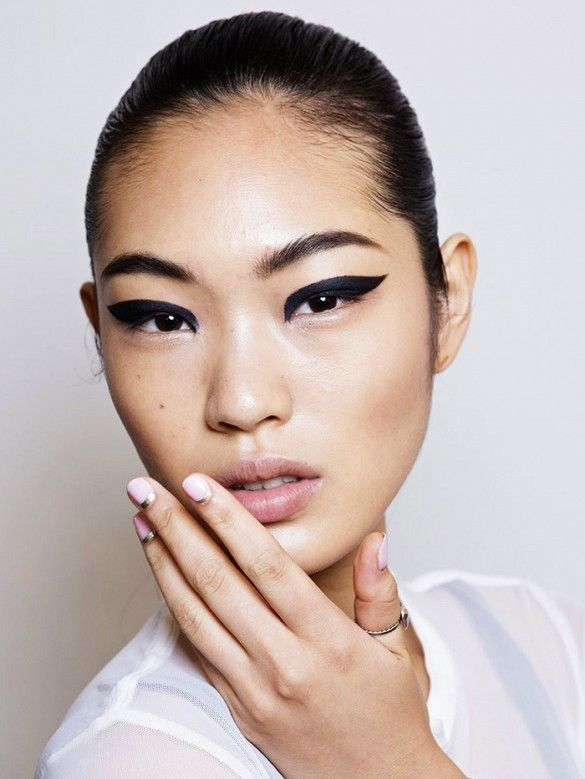Dramatic winged eyeliner and ultra cool nail art at Cushnie et Ochs NYFW SS15 backstage beauty