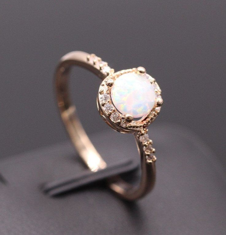 Looking for an original engagement ring or a special gift to celebrate a milestone occasion? This absolutely stunning classic Round Cut Opal Ring is the perfect piece! The Main Stone of this ring is a