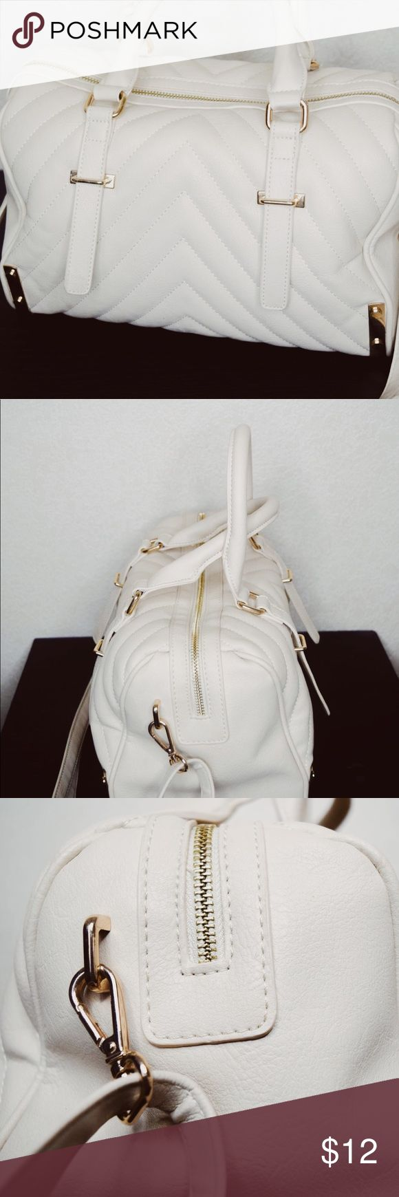 Super Cute Charming Charlie Off-White Handbag This off-white Handbag purchased at Charming Charlie's is perfect for the upcoming spring season! This neutral purse will pair perfectly with almost every outfit you pair it with and has all the space you need for your on-the-go essentials! Charming Charlie Bags Shoulder Bags