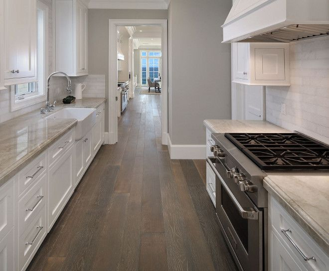 The prep-kitchen also feature Taj Mahal Quartzite countertops. They're truly beautiful and very durable.