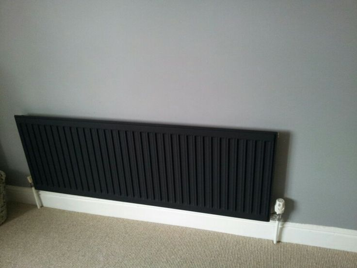 Painted black radiator, dead flat grey walls