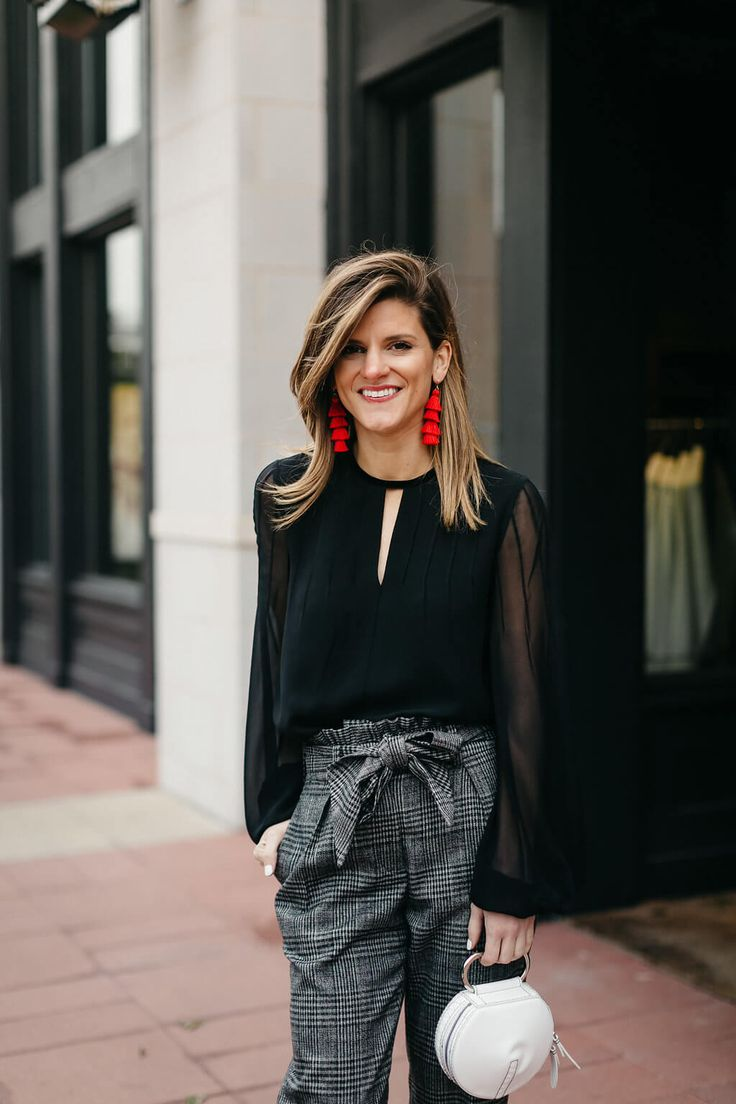 plaid trouser, black blouse, black pumps, and red tassel earrings
