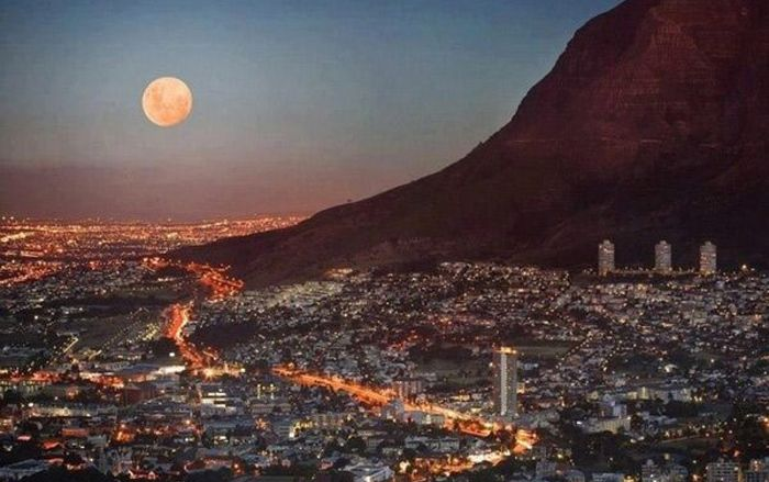 CAPE TOWN BY NIGHT - VIEW FROM TABLE MOUNTAIN ROAD.