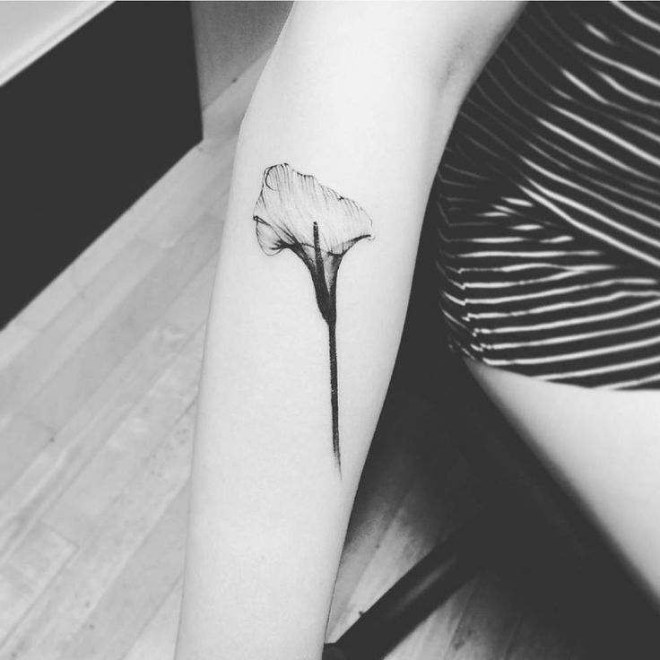X-Ray calla lily tattoo on the right forearm. Tattoo artist: Jay Shin
