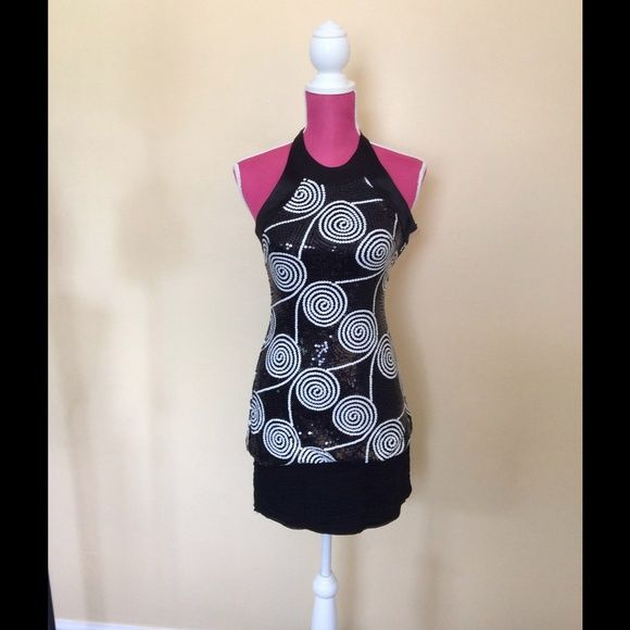 Cache black and white sequin dress One of the prettiest dresses ever!!  Black and white sequins in circular pattern. Satin trim around halter neck. Soft gathered band at bottom. Worn once. Like new. Gorgeous!! Cache Dresses