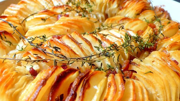 Crispy Potato Roast - lighter than a traditional potato bake, this recipe is so easy and delicious. The perfect side dish for a dinner party.