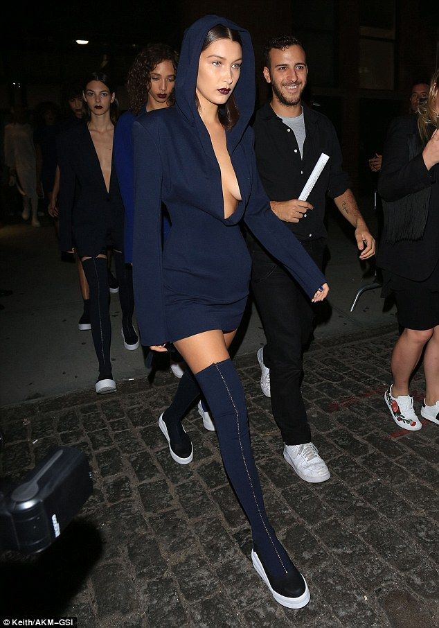 Fancy footwear:The younger sister of supermodel Gigi Hadid rocked sexy stretch thigh high boots with a white platform mid-sole heel