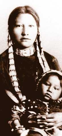 Many Horses (the daughter of Sitting Bull and Snow On Her), with her son - Hunkpapa - before 1897