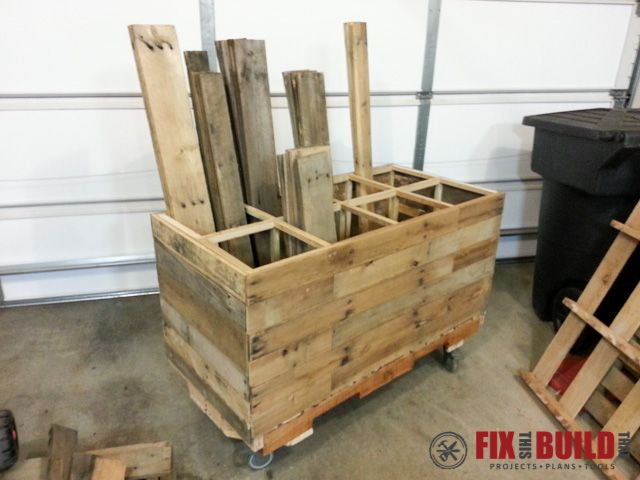 Need a pallet wood storage solution? This mobile pallet wood storage unit is easy to make and of course is made all out of pallets!
