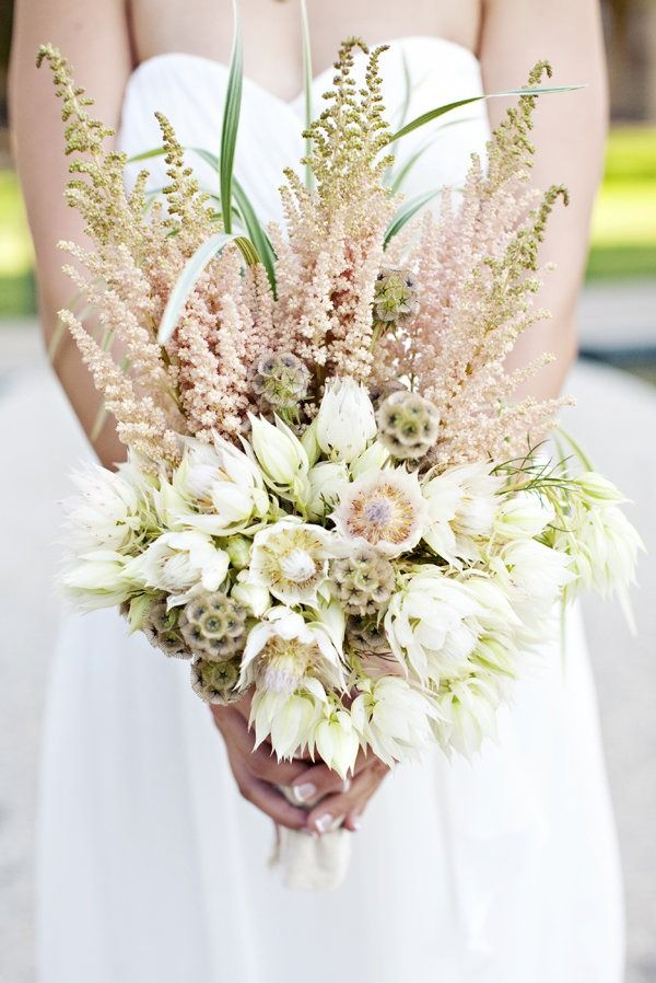Not a huge fan of the taller flowers, but love, love, love the base part of the boquet. That would be enough for me!
