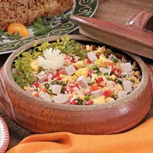 """Pork Fried Rice Recipe -""""My husband anxiously awaits the nights we have pork because he knows I'll use the leftovers in this recipe,"""" explains Norma Reynolds of Overland Park, Kansas. """"Add a few fortune cookies to make the meal special."""""""